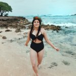 three black swimsuits to shop